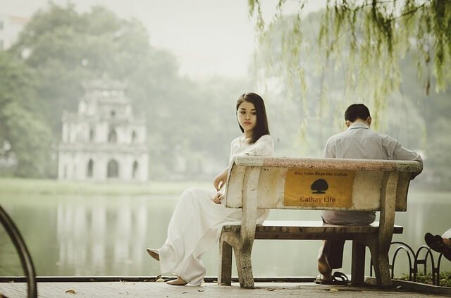 Sad couple on bench
