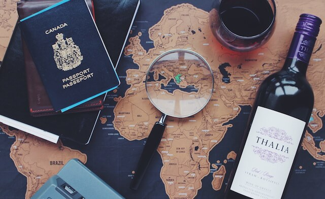 Map with passport and wine