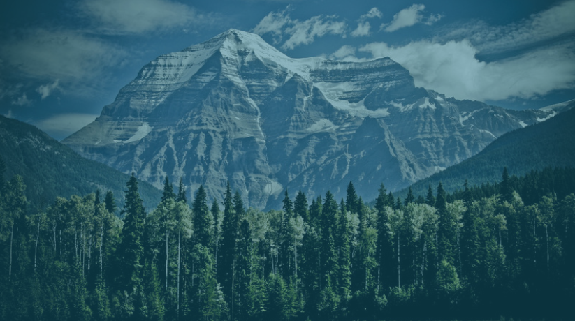 A website header image of mountains with a dark blue semi-transparent overlay, created with Canva.
